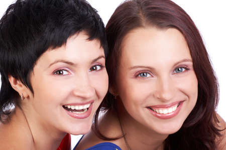 Happy young women friends laughing.  Over white background Stock Photo - 2505712