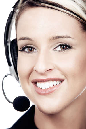 customer service representative: Serious  pretty business woman with headset. Over white background   Stock Photo