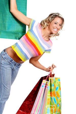 Shopping  woman smiling. Isolated over white background  photo