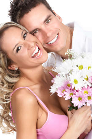 Young love couple smiling. Over white background  r