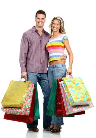 Shopping  couple  smiling. Isolated over white background Stock Photo - 2505751