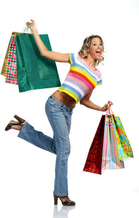 Shopping  woman smiling. Isolated over white background Stock Photo - 2505757