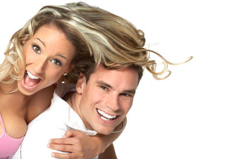 Young love couple smiling. Over white background Stock Photo - 2505739