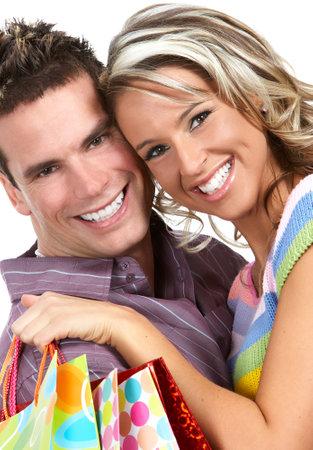 Shopping  couple  smiling. Isolated over white backgroundr photo