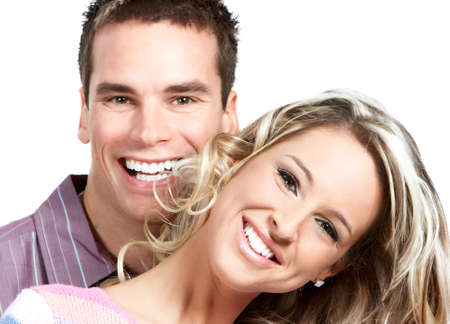 Young love couple smiling. Over white background Stock Photo - 2505735