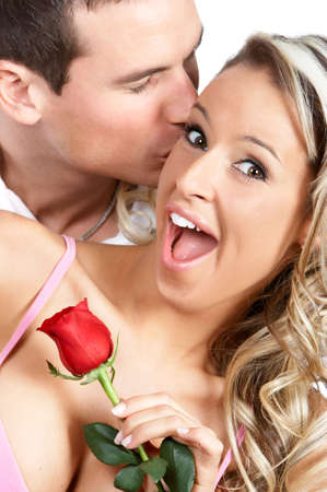 sweet love: Young love couple smiling. Over white background  r