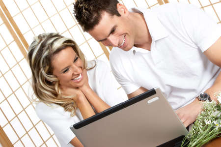 Young love couple with laptop. Over white background Stock Photo - 2505737