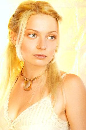 Pretty girl over golden background  photo