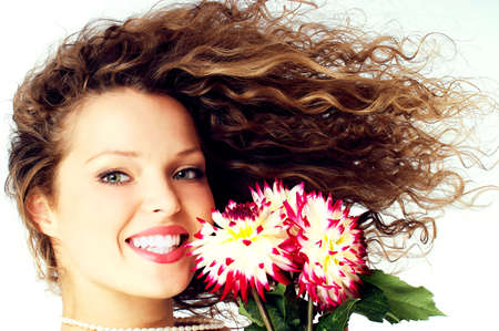 flyaway: Pretty girl with great fly-away hair holding flowers.  Stock Photo