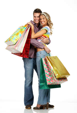 Shopping  couple  smiling. Isolated over white backgroundr photo