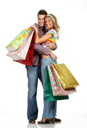 Shopping  couple  smiling. Isolated over white backgroundr