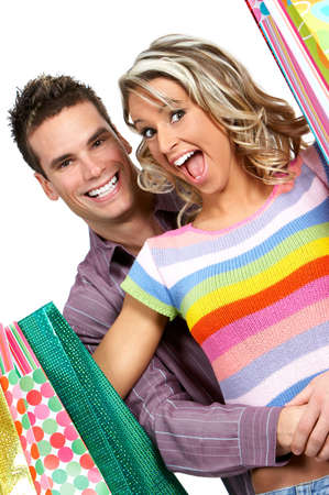 Shopping  couple  smiling. Isolated over white background Stock Photo