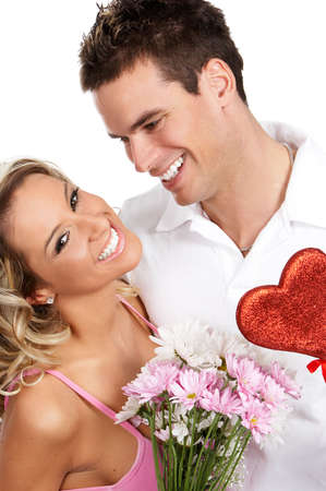Young love couple smiling. Over white background   photo