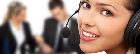 handsfree phones: Smiling  pretty business woman with headset.   Stock Photo