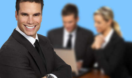 Smiling businessman and team. Over blue background Stock Photo - 2558139