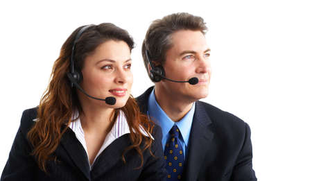 Smiling  business people  with headsets. Over white background Stock Photo - 2775570
