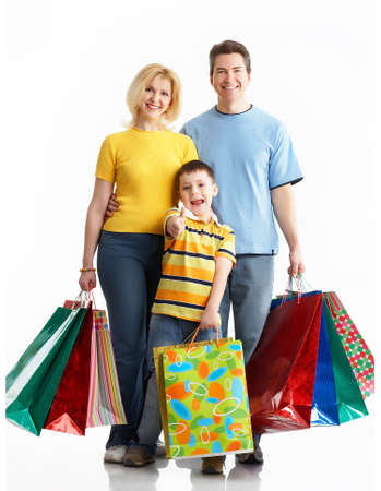 Happy family shopping. Isolated over white background Stock Photo - 2775530