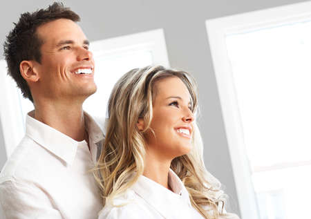 Young love couple smiling in the comfortable apartment Stock Photo - 2775298