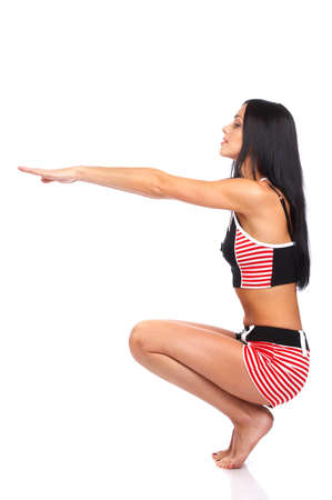 Fitness young woman doing exercise. Isolated over white background photo