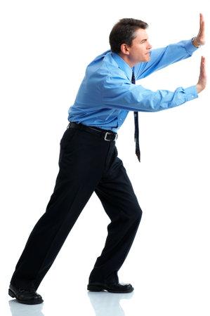 Businessman pushing . Isolated over white background  Stock Photo