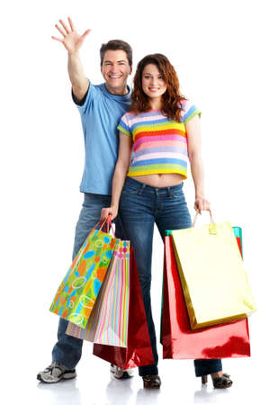fash: Shopping  couple  smiling. Isolated over white backgroundr