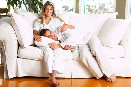 couple on couch: Young love couple resting  in the comfortable apartmentr
