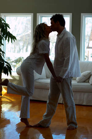 sexy girls kissing: Young love couple smiling in the comfortable apartmentr
