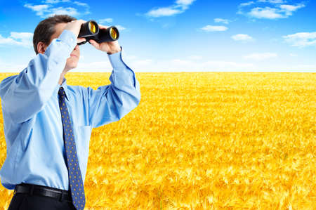 agronomist: business man  with binoculars looking to the future