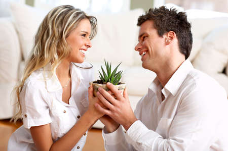 Young love couple smiling in the comfortable apartment Stock Photo - 2775511