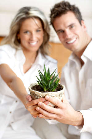 Young love couple smiling in the comfortable apartment Stock Photo - 2775303