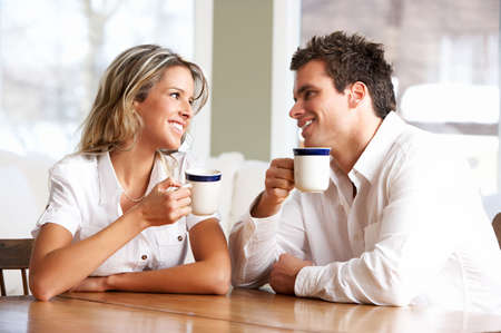 Young love couple taking breakfast  in the comfortable apartmentr