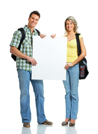 Young smiling  students with placard. Over white background  photo