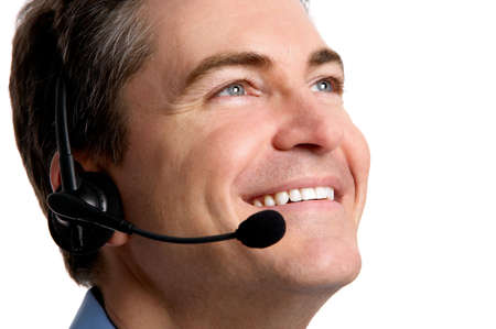 Smiling  business man with headset. Over white background   photo