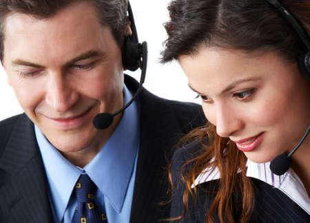 Smiling  business people  with headsets. Over white background Stock Photo - 2795317
