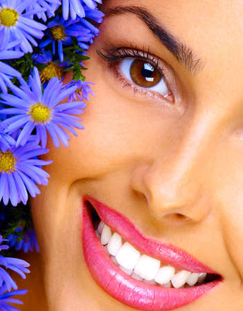 Happy young smiling woman with bunch of flowers  photo