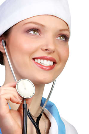 Medical doctor  with stethoscope smiling. Isolated over white  photo