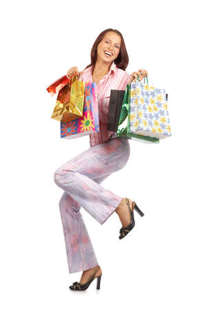 Shopping pretty woman with bags. Isolated over white background  Stock fotó