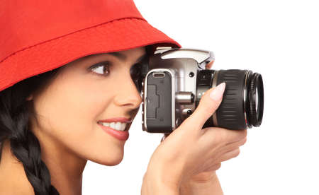 Young beautiful smiling woman holding a photo camera. Isolated over white background  photo