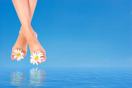 Beautiful woman legs over clean blue water