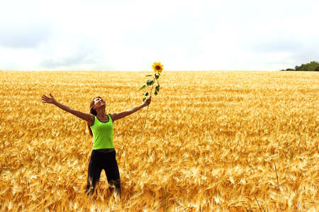 Happy young woman in the field Stock Photo - 2807122