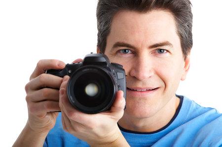 写真のカメラを持つ人。白で隔離 写真素材