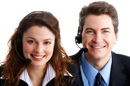 handsfree phones: Smiling  business people  with headsets. Over white background   Stock Photo