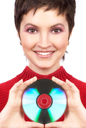 Young woman holding a cd-rom. Isolated over white  photo