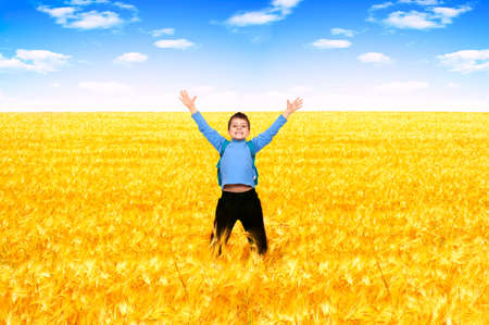 Funny jumping boy under blue sky Zdjęcie Seryjne