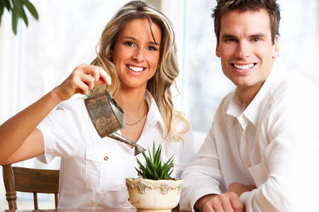 settler: Young love couple smiling in the comfortable apartmentr