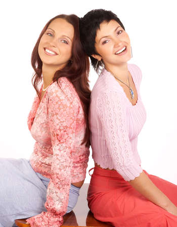 Happy young women friends laughing.  Isolated over white background  photo