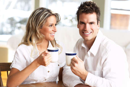 settler: Young love couple taking breakfast  in the comfortable apartmentr