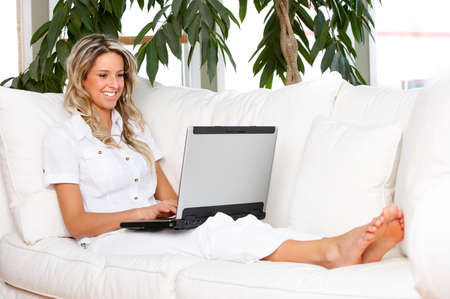 Young beautiful woman working with laptop  in the new  comfortable apartmentr photo