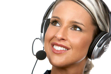 Beautiful  business woman with headset. Over white background Stock Photo - 2835091