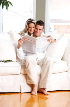 Young love couple reading magazine  in the comfortable apartment Stock Photo - 2835073